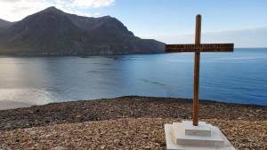 Iceland, Road no. 94, Njardvik Screes, wooden cross